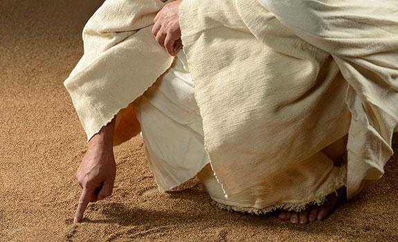 Jezus schrijft in het zand